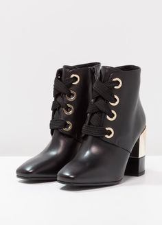 Black boots with golden details