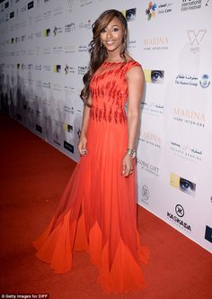 Lady in red: Alexandra Burke must be spoiled for choice when it comes to clothes - and cle...