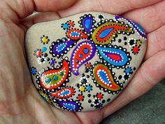 paisley dreams. paisley dance. Painted rock (sea stone) from Cape Cod A beautiful stone, worn smooth over time being tumbled in the sea, feels