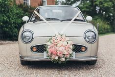 A Nissan Figaro is the perfect car to arrive in if you're having a vintage themed wedding - why not contact local car clubs to see if anyone minds giving you a lift in theirs?