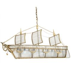 SOLD A Continental Crystal and Gilt-Metal Mounted Ship Chandelier | From a unique collection of antique and modern chandeliers and pendants at https://www.1stdibs.com/furniture/lighting/chandeliers-pendant-lights/