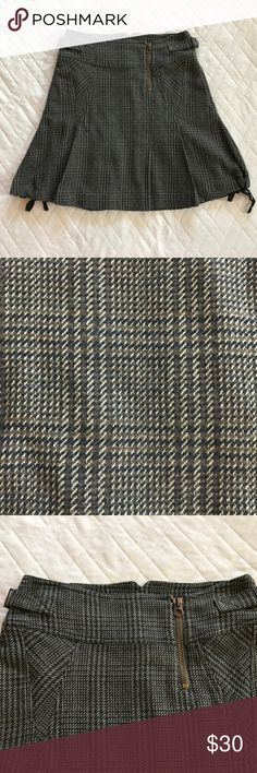 Max & Co. Plaid Rocker Skirt Pleat w/ Ties 6 Dark green, off-white and brown plaid skirt with pleating and ribbon ties on bottom.  Adjustable side pull tabs and front, off-center zipper.  Fully lined.  Material is a cotton, wool and nylon blend.  Skirt length measures approximately 19.5 inches.  Excellent pre-owned condition. Max & Co. Skirts