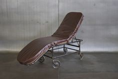 i love this. bc that's how I roll. -from the tv to the kitchen, all whilst lounging.    VINTAGE LEATHER LOUNGE CHAIR