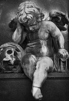 Putto (no, not a cherub, see en.wikipedia.org/wiki/Putto) with skull at Montparnasse cemetery in Paris.  This picture was used to illustrate a chapter in THE BIG WAKE-UP, a novel by Mark Coggins.  See more on the book here: www.markcoggins.com/book/wakeup.html