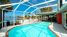Anna Maria Island vacation rental 623 Ivanhoe Lane is located on Key Royale and  a Bimini Bay canal leading out to Tampa Bay. This is the perfect 6 person rental for boating and fishing off the dock!