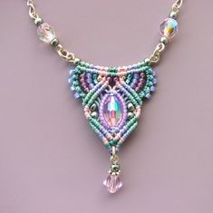 Macrame Necklace -Micro Macrame with glass beads, aqua green, peach,lavender, pink. $52.00, via Etsy.