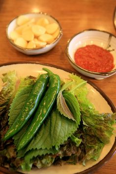 "In Korean restaurant, usually bulgogi or bbq serves with green vegetables (lettuce and sesame leaves). It's for eating as ""Ssam"". Ssam is a Korean style wrap. Usually ssam is rice and other ingredients wrapped in leafy greens."