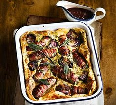 Ultimate toad-in-the-hole with caramelised onion gravy: Wrap fat sausages in streaky bacon for a posh version of a British classic - perfect comfort food for the whole family Sausage Recipes, Pork Recipes, Cooking Recipes, Bbc Good Food Recipes, Dinner Recipes, Yummy Food, Hot Dogs, English Food, Main Meals