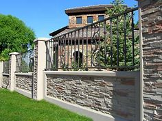 My future fence to inclose my property. Iron Fence with stone wall