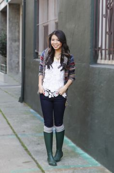 Colorful sweater, lace top, and rain boots