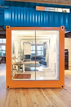 Shipping Container Loft | The loft is owned by Jeff Wardell and Claudia Sagan -- street art collectors.  The couple decided to purchase a 3,200-square- foot former Chinese laundry and tooth-powder factory. It had a very large and column-free interior that allowed them to divide the space as they wanted.