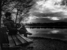 Sitting at the lake - Pinned by Mak Khalaf Black and White BenchBlack and whiteCloudsDogLakeReflectionSittingSkySerenity by DrMoAusHoh