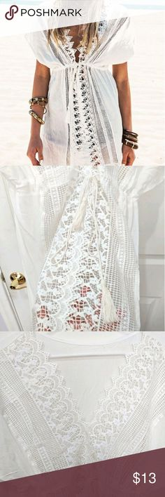 🌊crochet beach cover up🌊 super adorable white crochet beach cover up it is one size but it wouldn't fit bigger than a size large!! please keep this in mind i marked it as medium because it would probably best fit medium/large in perfect condition, i never wore it because it doesn't fit Tops Blouses