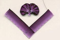 #2 of 5 How to make ribbon pansy. Fold the tape and sew outside edge with running stitch, as shown in the picture. When pulling the thread we should get such petals. Please note - dark flower facing the outer edge and stitching cuts across the 'V' corner.