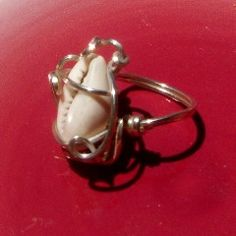 Cowrie Shell  Wire Wrap Ring  in SS Size 9. $75.00, via Etsy.