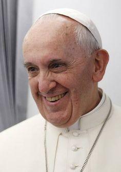 Pope Francis on plane to Rio de Janeiro