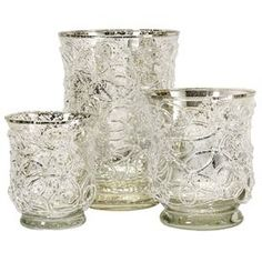 Perfect for bringing a warm glow to dinners or flickering ambiance to spring cocktail parties, this lovely set is a charming addition to your d�cor.     Product: Small, medium and large candleholderConstruction Material: GlassColor: Silver sparkleFeatures:  Brimming with seaside appealPerfect for bringing crisp coastal charm to your mantel Accommodates: (1) Candle each - not includedDimensions: Small: 3.75 H x 3 Diameter Large: 6 H x  4.75 Diameter