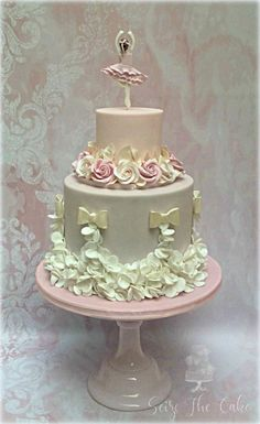 Elegant 2 tier ballerina birthday cake for a beloved young lady ! A simple ballerina topper and sugar roses wreath for the upper tier and petal ruffles for the bottom tier. Ballet Cakes, Dance Cakes, Ballerina Cakes, Dance Birthday Cake, Ballerina Birthday, Vintage Birthday Cakes, Baby Shower Cake Pops, Fairy Cakes, Birthday Cake Decorating