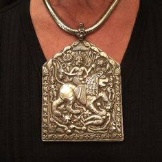 """Silver, India   Description  Equipped with a big """"snake chain"""" in old silver, this beautiful old silver extraordinary amulet  from Rajasthan whose very refined and detailed work represents the deity """"Durga"""" astride a lion slaying his enemies ...     Durga (Sanskrit, inaccessible) is one of the epithets of Parvati, consort of Shiva     Weight:368,1gr    Height:Pend : 5,74 inch    Width:Pend : 3,74 inch    Length:Snake chain : 17,32i    www.halter-ethnic.com...see """"My Lucky Finds"""""""
