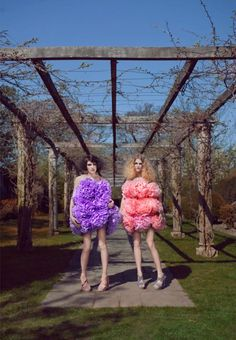 Giant pom-pom dresses or how to make supermodels look completely ridiculous.
