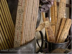 I LOVE yard sticks for some reason.... Someday I will find awesome things to do with them.  Antique Rulers Displayed In Antique Trophies