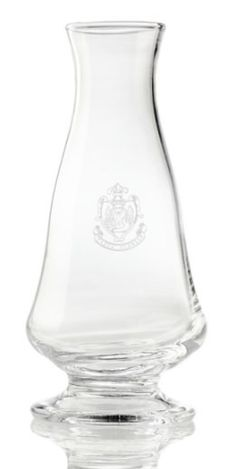 """""""Florina"""" carafe Part of the Florian's service since the turn of the Century, this beautiful carafe is crafted from blown glass and etched with the Florian Crest."""