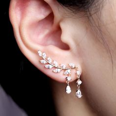 """Shimmery crystal vine earrings to """"plant"""" in your lobes."""