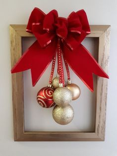 Red and gold ornaments hang from the large coordinati. Red and gold ornaments hang from the large coordinating red bow. Pinterest Christmas Crafts, Xmas Crafts, Christmas Projects, Christmas Holidays, Christmas Ornaments, Gold Ornaments, Picture Frame Wreath, Christmas Picture Frames, Picture Frame Crafts