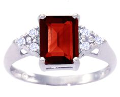 emerald cut garnet and diamond ring in white gold.....my daughter's birthstone.