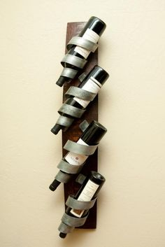 wine rack that can be hung either vertically or horizontally. The base of the rack is made from an oak wine barrel stave which is sanded and stained by hand. Unique Wine Racks, Wine Rack Design, Barrel Projects, Wine Rack Wall, Wine Wall, Bottle Rack, Wine Storage, Storage Racks, Blacksmithing