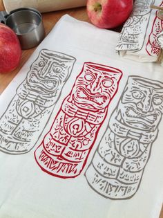 Adorable, hand screen printed Tiki dish towel!    100% Cotton, washable flour sack dish towel(1) measures approx 28x29 - Print measures approx. 7.5x7.5 - and is super absorbant and lint free. Print is in Deep Red & Bright Brown on one white towel. Comes packaged in very sweet natural cardstock & grosgrain ribbon ring with matching graphic on the front - Makes a PERFECT housewarming or hostess gift!    *Please note* colors may vary slightly between real life & computer monitor