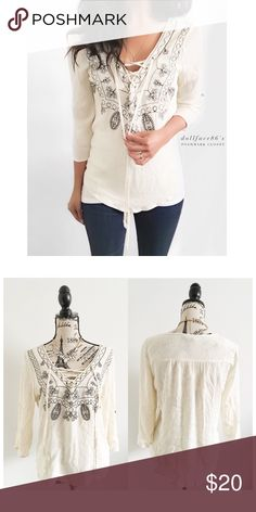 """Cream & Black Embroidered Lace Up Top This boho top has a black floral embroidered  front with a light cream crinkled fabric, quarter inch style sleeves & a stylish lace up front. {actual color of item may vary slightly from pics}  *chest:19"""" *waist:8"""" *length:24"""" *sleeves:20"""" *material/care:rayon/machine wash  *fit:might work for med/sml as well  *condition:good no rips/stains   🌸20% off bundles of 3/more items 🌸No Trades  🌸NO HOLDS 🌸No transactions outside Poshmark  🌸No lowball offers…"""