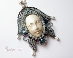 MarieClaire Vastra (Zoeprune) ~ Iridescent Wisdom Face Pendant. Both the lovely micro macrame & the polymer clay face itself are handmade by the artist. I love *love* the detail she's put into this & her choice of, as well as the placement of, the beads used to adorn the headdress of what could easily pass for a Priestess.
