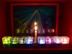 Tissue paper + Mod Podge + votive candle holders = awesome menorah!