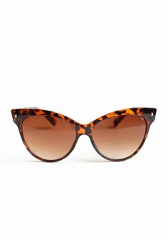 "Contessa Cat Eye Sunglasses By A.J. Morgan 14.99 at shopruche.com. Perfected with a classic cat eye frame, these translucent faux tortoise shell glasses are completed with UV protectant ombre lenses.5.5"" x 2.25"""