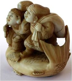 19th Century Isawa School Ivory Netsuke  Ebizu and Daikoku Riding Large Carp  Signature: Meigyoku, Circa: 19th Century A beautifully skilled rendering of Ebizu and Daikoku, the Japanese gods of bounty, clowning on top a large carp. Done in great detail; from the varied patterns of Ebizu's robe and his characteristic fishing pole, to the faux wood grain on Daikoku's mallet, a warm golden patination covers the entirety of ivory.