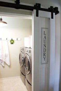 Doing laundry is more fun when surrounded by sleek decor like this sliding door. Learn more at A House and A Dog.