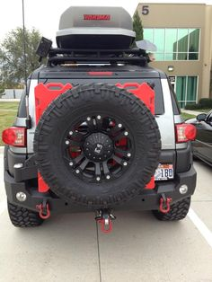 Rotopax cans mounted on Expedition One Rear Swing Out - Toyota FJ Cruiser Forum