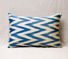 Navy Ikat Pillow >> I need to get some similar fabric and make one of these!