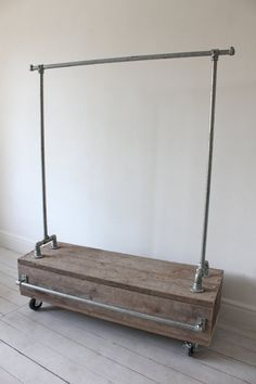 Cool looking and very functional industrial pipe clothing rack with storage drawer. Find more great #IndustrialPipeFurniture ideas at http://wiselygreen.com/15-industrial-pipe-furniture-and-home-projects-for-diyers/