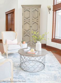 Our Spring Grand Foyer Decorating Ideas featuring these gorgeous chairs, rustic cabinet, coffee table and rug from Homegoods (sponsored) #spring #decorating #foyer #springdecorating #rustic