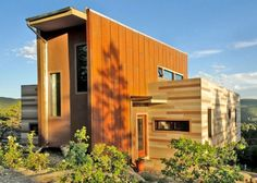 This Nederland, Colorado container home, designed by Studio H:T, performs at net-zero energy consumption by utilizing passive strategies of insulation and orientation, active solar photovoltaic and thermal systems, and the harvesting of on-site renewable fuel (timber is selectively and sustainably cleared to burn in the high-efficiency wood stove).
