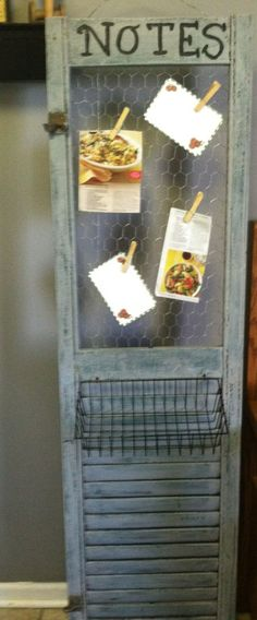 shutter repurposed with chicken wire insert to hold notes and attached wire basket