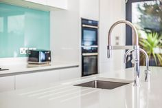 Our beautiful Nolte Handleless Kitchen in Feel White and Quartz Grey - Adjourned with aqua blue glass splash backs and a Quooker tap! Kitchen Ideas, Kitchen Design, Handleless Kitchen, German Kitchen, Bespoke Kitchens, Aqua Blue, Sink, Quartz, Grey