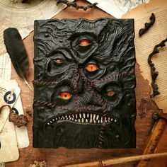 If you appreciate impeccable hand craftsmanship and an eye for monstrous detail you'll be amazed by this Monster Book from Canadian artist, Mille Cuirs. These leather grimoire blank Monster Eyes, Monster Book Of Monsters, Necronomicon Lovecraft, Grimoire Book, Libros Pop-up, Leather Books, Leather Pieces, Halloween Books, Custom Book