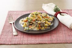 Our beef and noodle casserole is creamy and flavorful, with smart ingredient swaps that include reduced-fat cream of mushroom soup and cheddar cheese.