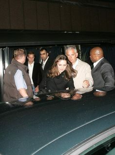 December 20, 2006 - Kate getting into a car in London.  You can see Prince William behind her.