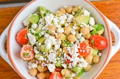 This chickpea, tomato and avocado salad is a healthy vegetarian dish. It has tomatoes, avocado, feta cheese, chickpeas, and onions with a simple dressing.