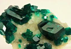 Dioptase, CuSiO3. H2O, and Calcite,CaCO3    Locality: Namibia