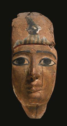 Wooden mummy mask. 3rd Intermediate Period. 1075-716 B.C. | Sotheby's
